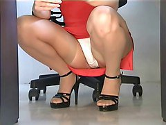 Squatting stockings upskirt in the office