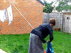 Sissy Housewife Hangs Out The Washing