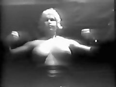 old time naked strong woman pecs and traps... wow!